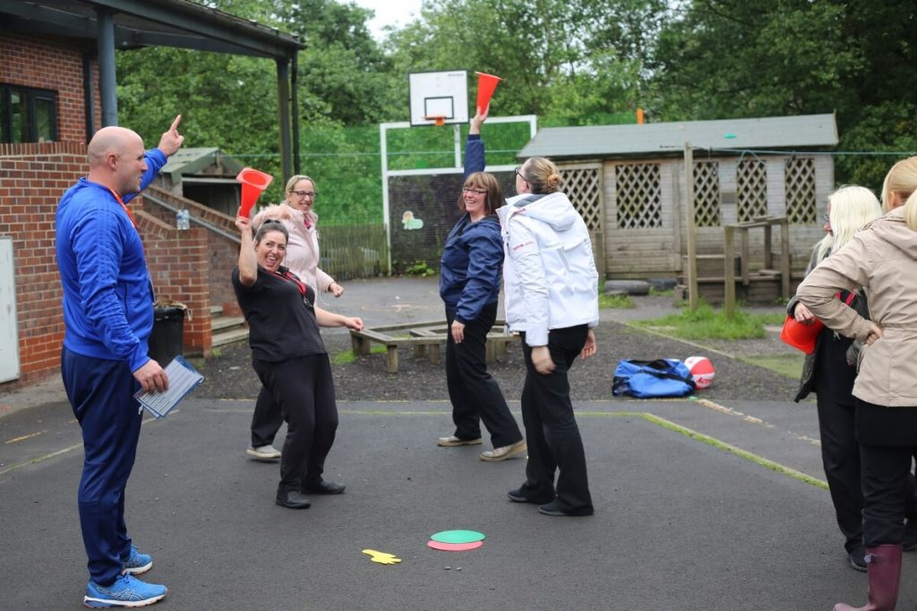 Nursery Staff Play Outdoor Games