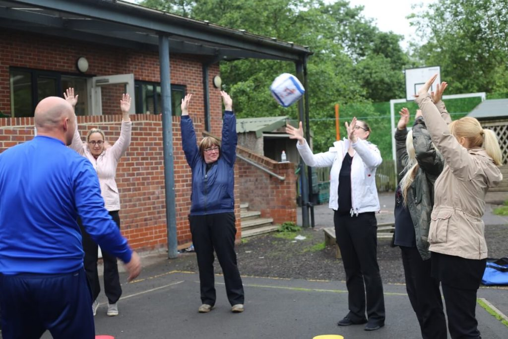 Nursery Staff Playing Catch